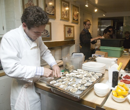 Chef Jared Stafford-Hill prepares oysters for the Maison Premiere Seafood Tower